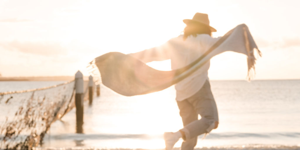 Person-Dancing-On-Beach