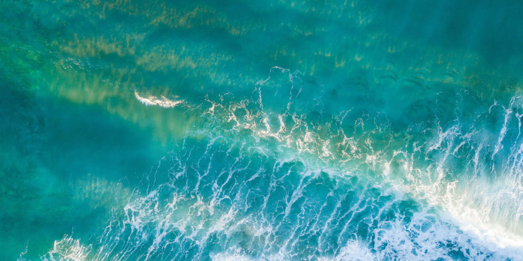 aerial-photography-of-sea-waves-during-daytime